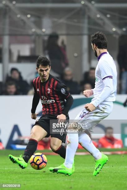 AC Milan's Spanish forward Fernandez Suso vies with Fiorentina's Italian defender Davide Astori during the Italian Serie A football match between AC...