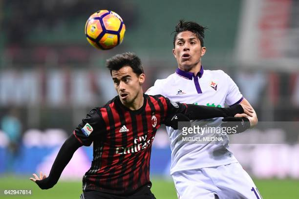 AC Milan's Spanish forward Fernandez Suso vies with Fiorentina's Mexican defender Carlos Salcedo during the Italian Serie A football match between AC...