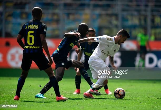 AC Milan's Spanish forward Fernandez Suso vies with Inter Milan's French midfielder Geoffrey Kondogbia during the Italian Serie A football match...