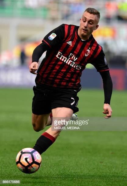 AC Milan's Spanish forward Gerard Deulofeu controls the ball during the Italian Serie A football match AC Milan vs Palermo at the San Siro stadium in...