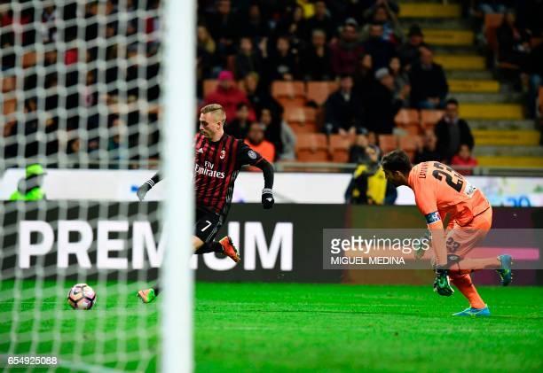 AC Milan's Spanish forward Gerard Deulofeu outruns Genoa's goalkeeper Eugenio Lamanna during the Italian Serie A football match AC Milan vs Genoa at...