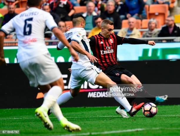 AC Milan's Spanish forward Gerard Deulofeu vies with Empoli's French defender Vincent Laurini during the Italian Serie A football match AC Milan vs...