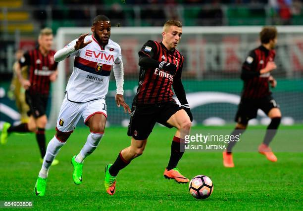 AC Milan's Spanish forward Gerard Deulofeu vies with Genoa's French midfielder Olivier Ntcham during the Italian Serie A football match AC Milan...
