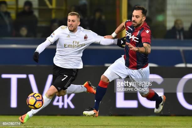 AC Milan's Spanish midfileder Gerard Deulofeu vies for the ball with Bologna's Italian defender Domenico Maietta during the Italian Serie A football...