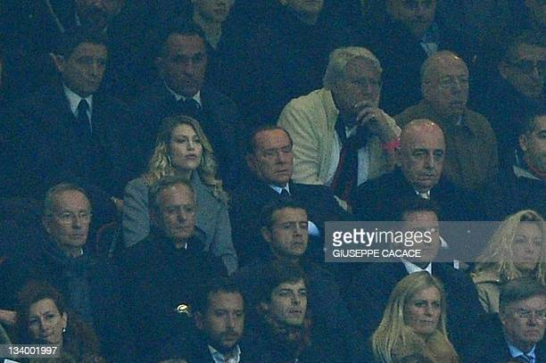 AC Milan's sporting director Adriano Galliani AC Milan's president Silvio Berlusconi and Barbara Berlusconi watch the Champions League group H...