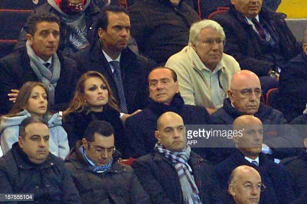 AC Milan's sporting director Adriano Galliani and AC Milan's president Silvio Berlusconi attend the Champions league match between AC Milan and...