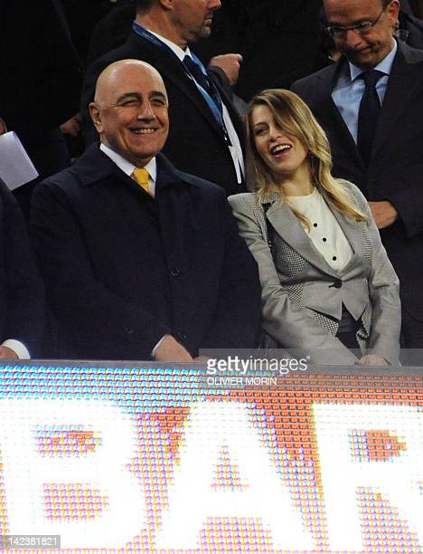 AC Milan's sporting director Adriano Galliani and Barbara Berlusconi stand in the tribune during the Champions League quarterfinal second leg...