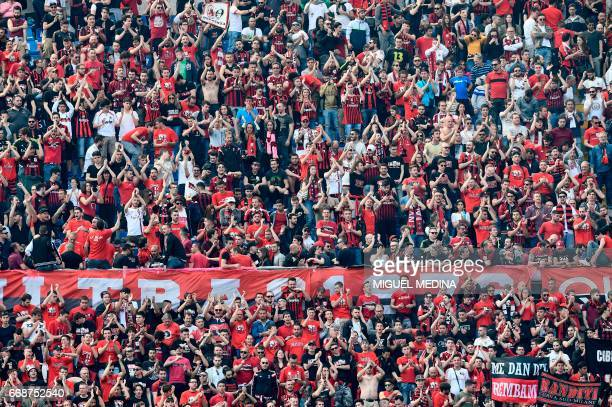 AC Milan's supporters before the Italian Serie A football match Inter Milan vs AC Milan at the San Siro stadium in Milan on April 15 2017 / AFP PHOTO...