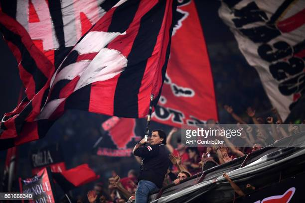 AC Milan's supporters wave flags before the Italian Serie A football match Inter Milan Vs AC Milan on October 15 2017 at the 'San Siro Stadium' in...