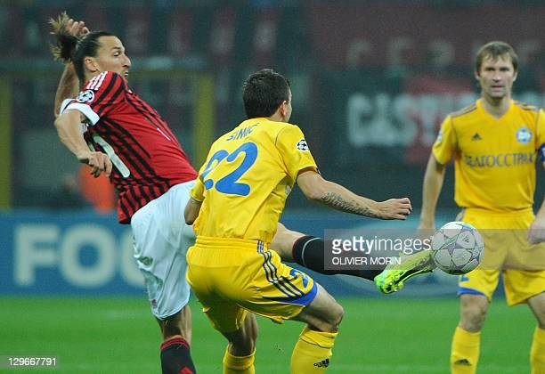 AC Milan's Swedish forward Zlatan Ibrahimovic fights for the ball against Bate Borisov's serbian defender Marko Simic during their Champions League...