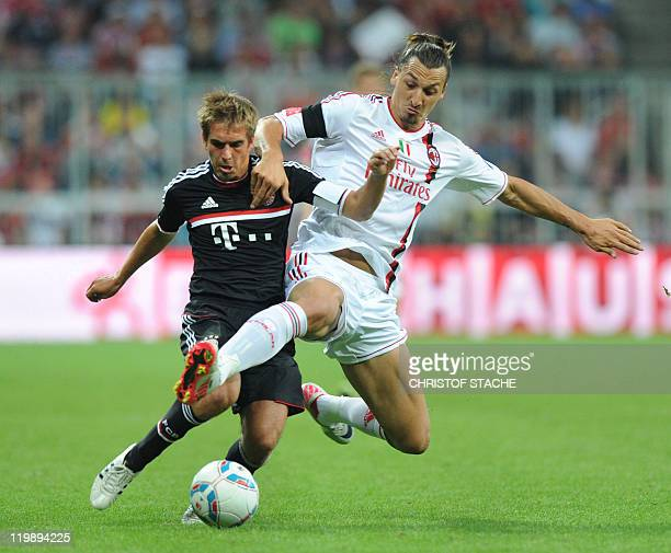 AC Milan's Swedish striker Zlatan Ibrahimovic and Bayern Munich's defender Philipp Lahm challenge for the ball during the Audi Cup football match...