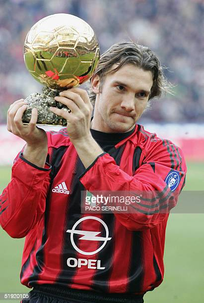 Milan's Ukrainian forward Andriy Shevchenko shows his Golden Ball European Footballer of the Year trophy to supporters before their Italian serie A...