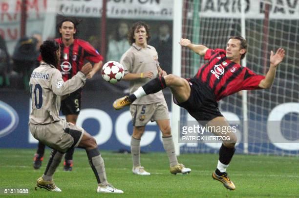Milan's Ukrainian forward Andriy Shevchenko vies with FC Barcelona's Brazilian opponent Ronaldinho during their Champions League group F football...