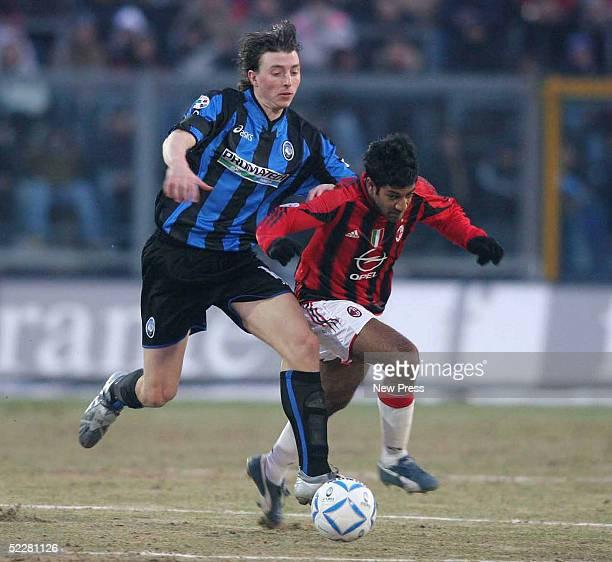 Milan's Vikash Dhorasoo and Atalanta's Riccardo Montolivo clash during the Serie A match between Atalanta and Milan at Stadio Atleti Azzurri d'Italia...