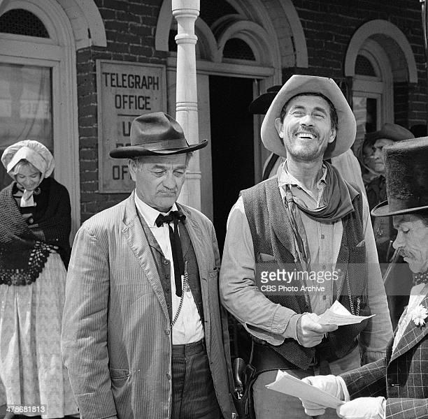 Milburn Stone as Doc Adams and Ken Curtis as Festus Haggen in the GUNSMOKE episode 'Circus Trick' Image dated June 8 1964