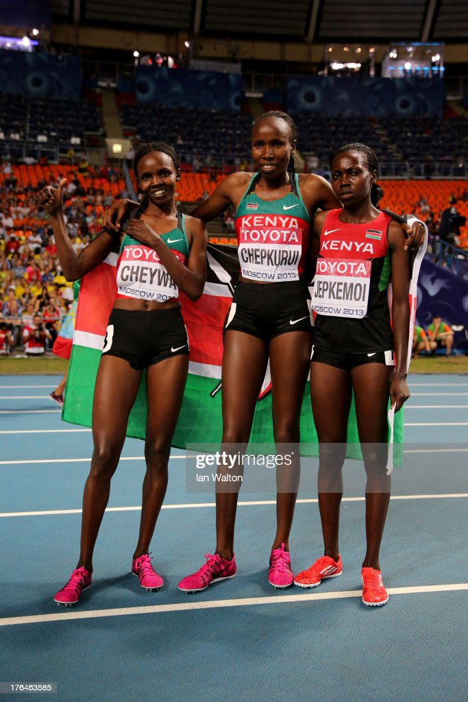 <a gi-track='captionPersonalityLinkClicked' href=/galleries/search?phrase=Milcah+Chemos+Cheywa&family=editorial&specificpeople=6147033 ng-click='$event.stopPropagation()'>Milcah Chemos Cheywa</a> of Kenya (L) celebrates winning gold with silver medalist Lydia Chepkurui of Kenya and Hyvin Kiyeng Jepkemoi of Kenya in the Women's 3000 metres steeplechase final during Day Four of the 14th IAAF World Athletics Championships Moscow 2013 at Luzhniki Stadium on August 13, 2013 in Moscow, Russia.