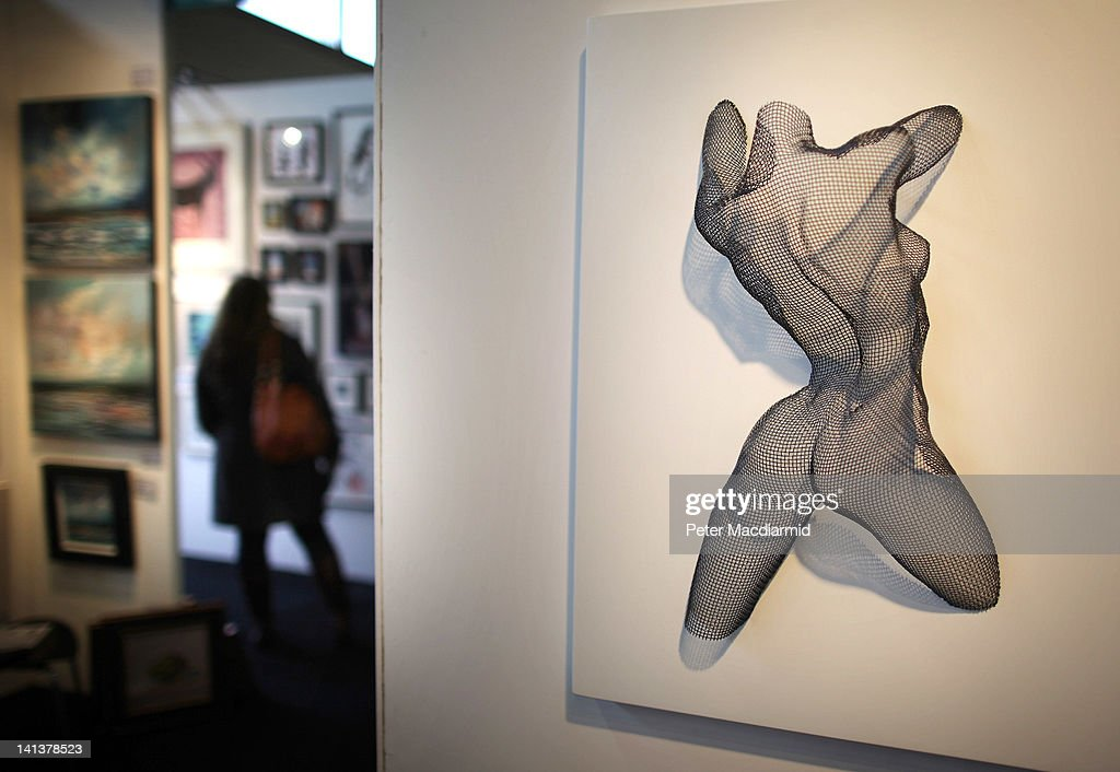 A mild steel mesh sculpture entitled 'Earth Dance' by artist Nikki Taylor is displayed at The Affordable Art Fair on March 15, 2012 in London, England. 120 galleries are displaying works costing from £40 - £4000. Photography, paintings, prints and sculptures are on sale from 15-18th March 2012.