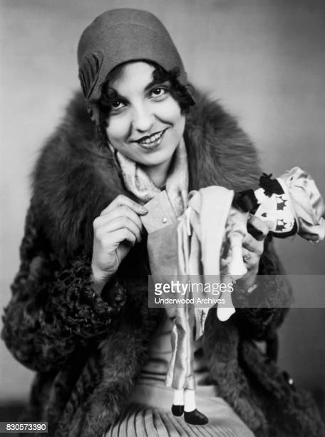 Mildred Brown with her custom Rag Doll which has a separate pocket for everything including lipstick rouge powder mirror handkerchief and purse...