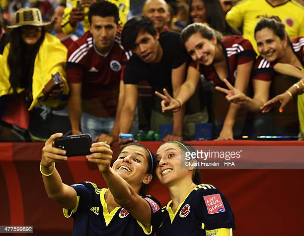 Mildrey Pineda and Natalia Gaitan of Colombia makes a selfie with fans after the FIFA Womens's World Cup Group F match between England and Colombia...