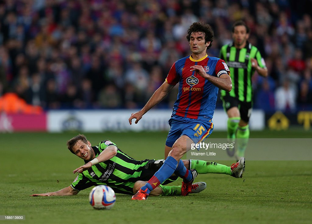 Mile Jedina, Captain of Crystal Palace tackles the ball off Dean Hammond of Brighton & Hove Albion during the npower Championship play off semi final first leg at Selhurst Park on May 10, 2013 in London, England.