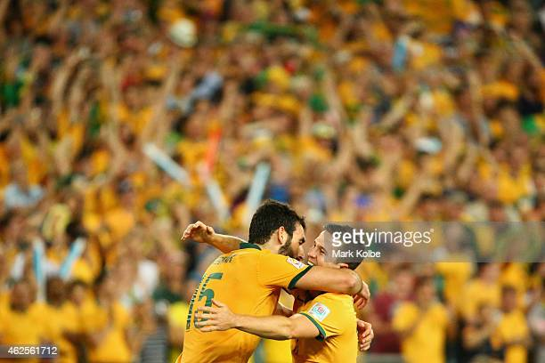 Mile Jedinak and Matt McKay of Australia celebrate victory during the 2015 Asian Cup final match between Korea Republic and the Australian Socceroos...