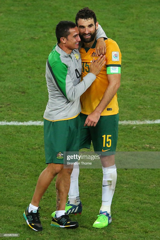 Mile Jedinak and Tim Cahill of Australia embrace at full time after victory over Korea Republic following the 2015 Asian Cup final match between Korea Republic and the Australian Socceroos at ANZ Stadium on January 31, 2015 in Sydney, Australia.