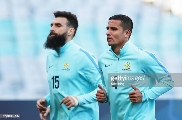 Mile Jedinak and Tim Cahill of Australia warm up during an Australian Socceroos training session at ANZ Stadium ahead of their World Cup 2018...