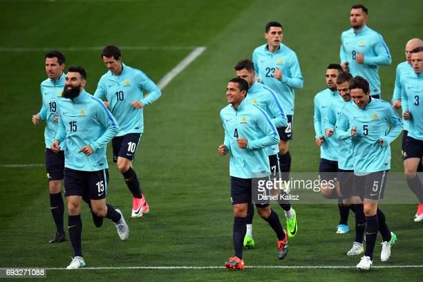 Mile Jedinak and Tim Cahill of Australia warm up during the Australian Socceroos training session at the Adelaide Oval on June 7 2017 in Adelaide...