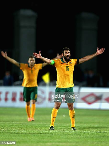 Mile Jedinak Captain Australia appeals to referee Khamis Mohammed Al Marri during the 2018 FIFA World Cup Qualifier match between Kyrgyzstan and the...