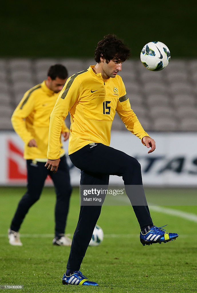 <a gi-track='captionPersonalityLinkClicked' href=/galleries/search?phrase=Mile+Jedinak&family=editorial&specificpeople=3123629 ng-click='$event.stopPropagation()'>Mile Jedinak</a> controls the ball during an Australian Socceroos training session at WIN Jubilee Stadium on June 13, 2013 in Sydney, Australia.