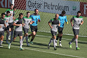 Mile Jedinak leads a pack of Socceroos during an Australian Socceroos Asian Cup training session at Cooks Hill No2 Sports Ground on January 25 2015...