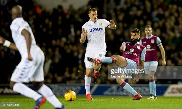 Mile Jedinak of Aston Villa is challenged by Chris Wood of Leeds United during the Sky Bet Championship match between Leeds United and Aston Villa at...
