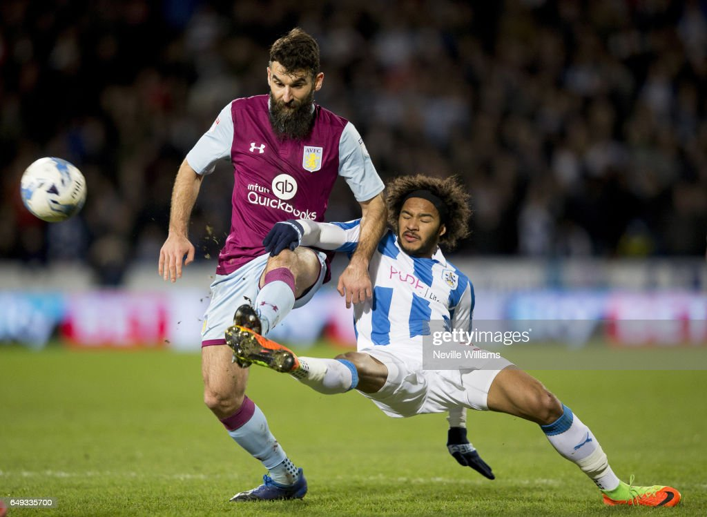 Mile Jedinak of Aston Villa is challenged by Isaiah Brown of Huddersfield Town during the Sky Bet Championship match between Huddersfield Town and Aston Villa at the John Smith's Stadium on March 07, 2017 in Huddersfield, England.