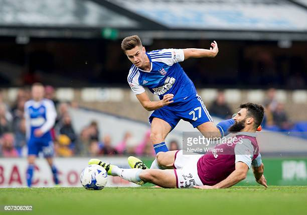 Mile Jedinak of Aston Villa is challenged by Tom Lawrence of Ipswich Town during the Sky Bet Championship match between Ipswich Town and Aston Villa...