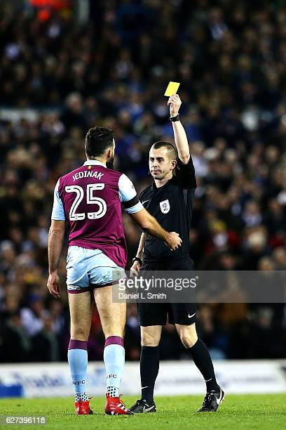 Mile Jedinak of Aston Villa is issued a yellow card for an illegal tackle against Hadi Sacko of Leeds United during the Sky Bet Championship match...