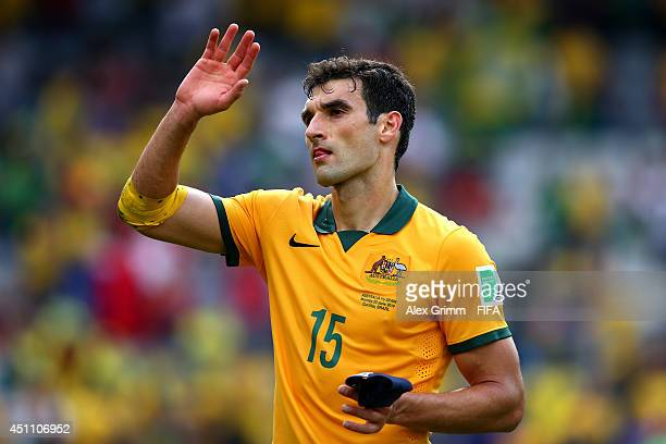Mile Jedinak of Australia acknowledges the fans after the 03 defeat in the 2014 FIFA World Cup Brazil Group B match between Australia and Spain at...
