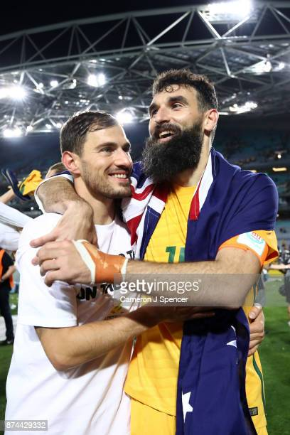 Mile Jedinak of Australia and James Troisi of Australia celebrate after winning the 2018 FIFA World Cup Qualifiers Leg 2 match between the Australian...