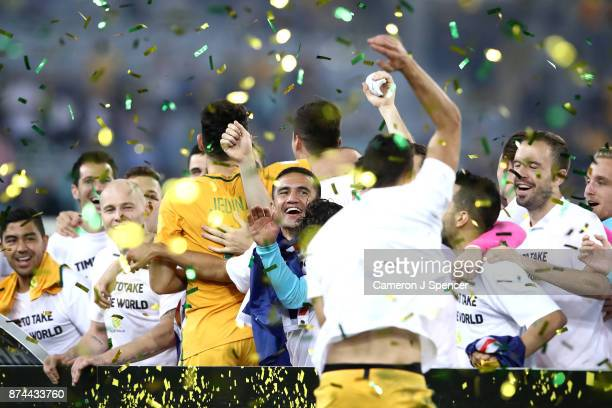 Mile Jedinak of Australia and team mates celebrate winning the 2018 FIFA World Cup Qualifiers Leg 2 match between the Australian Socceroos and...