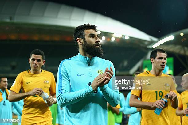 Mile Jedinak of Australia and team mates thank fans following the 2018 FIFA World Cup Qualification match between the Australia Socceroos and...