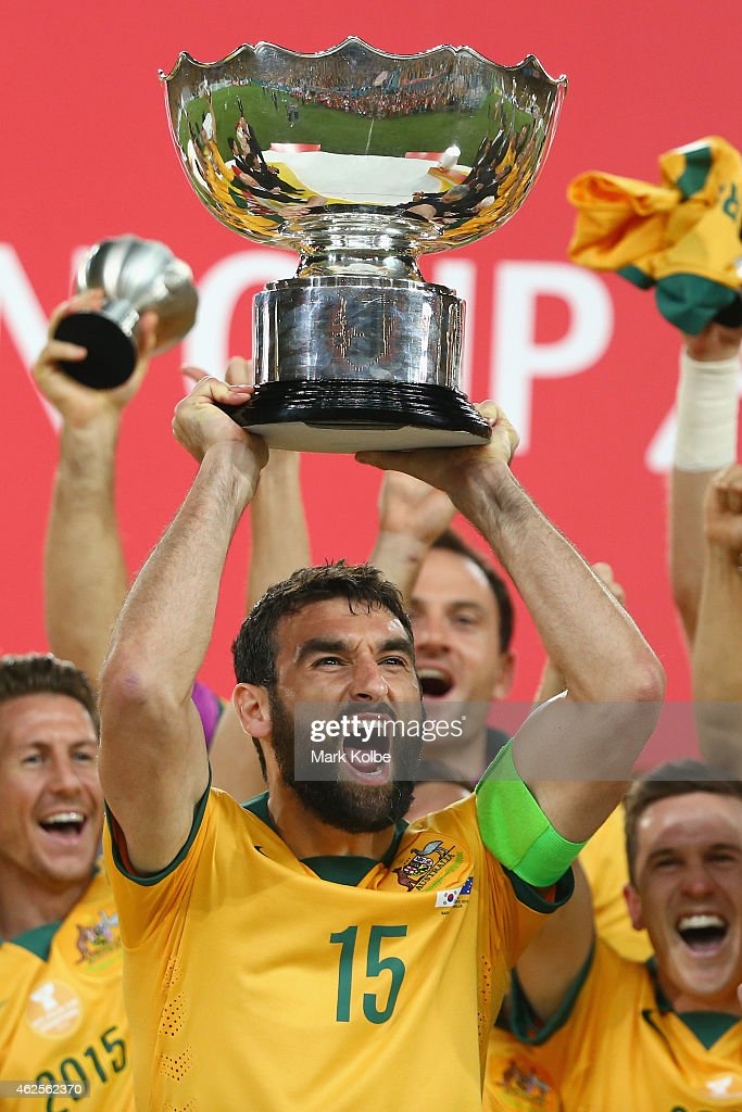 Mile Jedinak of Australia celebrates as he lifts the trophy after victory during the 2015 Asian Cup final match between Korea Republic and the Australian Socceroos at ANZ Stadium on January 31, 2015 in Sydney, Australia.
