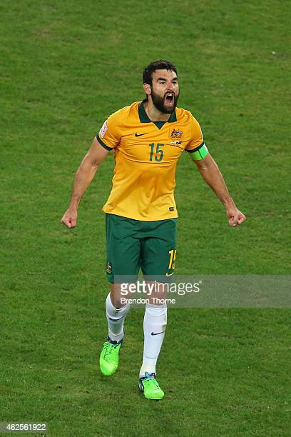 Mile Jedinak of Australia celebrates at full time after victory over Korea Republic following the 2015 Asian Cup final match between Korea Republic...
