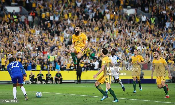 Mile Jedinak of Australia celebrates scoring his third goal and a hat trick during the 2018 FIFA World Cup Qualifiers Leg 2 match between the...