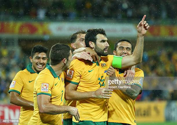 Mile Jedinak of Australia celebrates with team mates after he scored a penalty during the 2015 Asian Cup match between the Australian Socceroos and...