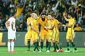 Mile Jedinak of Australia celebrates with team mates after scoring a goal during the 2018 FIFA World Cup Qualification match between the Australia...