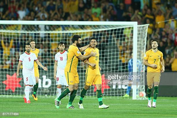 Mile Jedinak of Australia congratulates team mate Massimo Luongo of Australia after scoring a goal during the 2018 FIFA World Cup Qualification match...