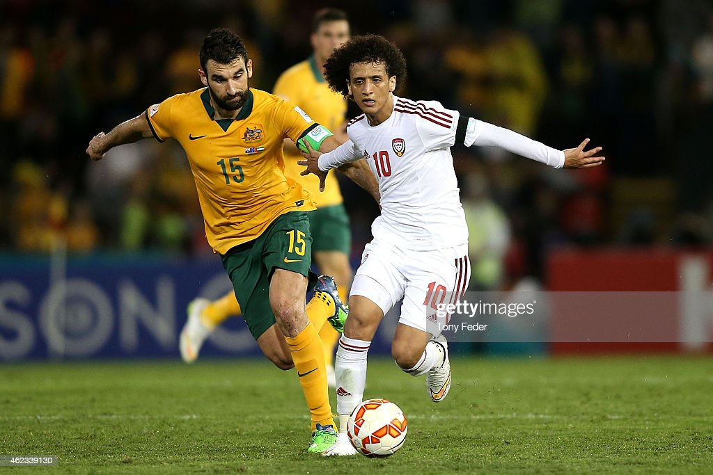 <a gi-track='captionPersonalityLinkClicked' href=/galleries/search?phrase=Mile+Jedinak&family=editorial&specificpeople=3123629 ng-click='$event.stopPropagation()'>Mile Jedinak</a> of Australia contests the ball with <a gi-track='captionPersonalityLinkClicked' href=/galleries/search?phrase=Omar+Abdulrahman&family=editorial&specificpeople=6420654 ng-click='$event.stopPropagation()'>Omar Abdulrahman</a> of The United Arab Emirates during the Asian Cup Semi Final match between the Australian Socceroos and the United Arab Emirates at Hunter Stadium on January 27, 2015 in Newcastle, Australia.