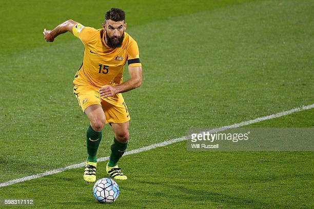 Mile Jedinak of Australia controls the ball during the 2018 FIFA World Cup Qualifier match between the Australian Socceroos and Iraq at nib Stadium...