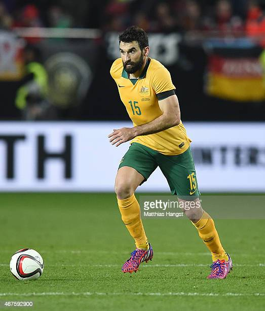 Mile Jedinak of Australia controls the ball during the International Friendly match between Germany and Australia at FritzWalterStadion on March 25...