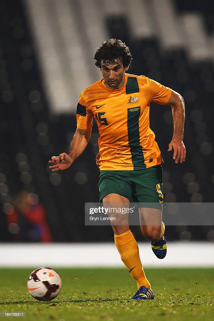 <a gi-track='captionPersonalityLinkClicked' href=/galleries/search?phrase=Mile+Jedinak&family=editorial&specificpeople=3123629 ng-click='$event.stopPropagation()'>Mile Jedinak</a> of Australia in action during the International Friendly between Canada and Australia at Craven Cottage on October 15, 2013 in London, England.