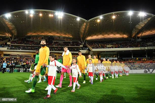 Mile Jedinak of Australia leads his players onto the field prior to the 2018 FIFA World Cup Qualifier match between the Australian Socceroos and...